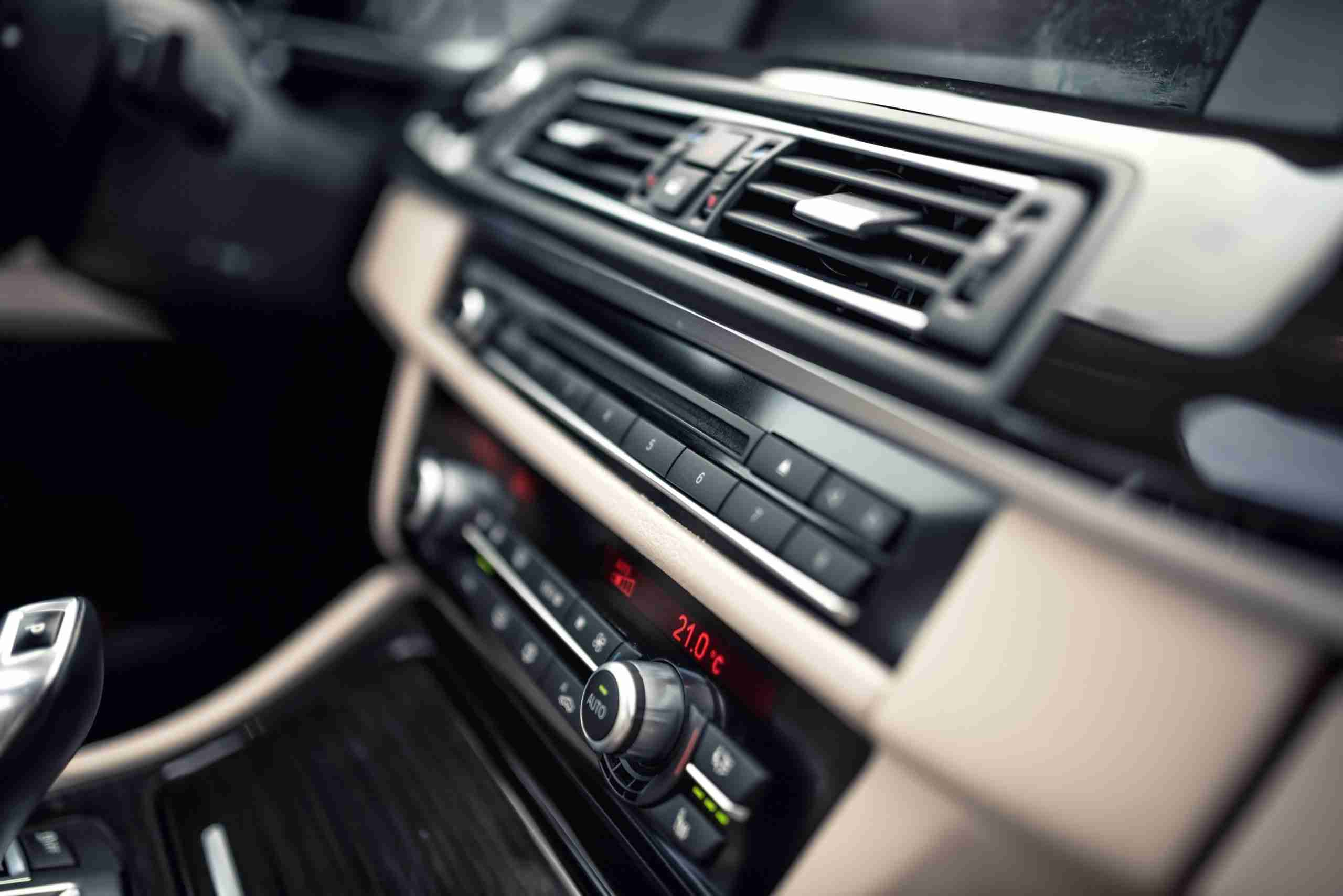 car ventilation system and air conditioning - details and controls of modern car. Concept wallpaper with minimalist industrial design